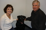 My partner, Catherine Seal, and our dog Mo.  Mo loves people and greets our clients everyday.