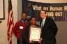 Human Rights Day, December, 2012; Forum on Education and Responsibility; Youth for Human Rights Director for Africa Jay Yarsiah, Pasadena team leader Khadejah Ray with Congressional certificate, and Tim Bowles