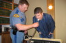A breath sample is being submitted by a subject participating in a Drinking Lab conducted at Woods & Brangwin, PLLC.