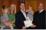 Originally from Canada, I was sponsored by my wife Jenni for a green card in 2001.  I became a U.S. citizen in October 2008 and above is a picture of me (and family) with Judge Piester who presided over my oath ceremony.
