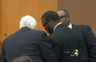 Mr. Kenner and his co-counsel confer with man who has pleaded guilty to double murder, regarding sentencing. Channel 2 Atlanta news reporting, April 11, 2013.