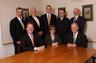 The partners of Rusk, Wadlin, Heppner, & Martuscello, LLO From L-R Front: Daniel J. Rusk, Pamela D. Rusk, George Rusk, Jr.  Back: Daniel M. Martuscello, Daniel G. Heppner, John G. Rusk, Jason J. Kovacs, and John J. Wadlin, (of counsel)