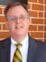 John E. Melton